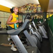 Onyx Mintah, a senior forward on Siena's women's basketball team. The last time Siena's facility was renovated was 1992, the year she was born. Green curtains separate this workout area from the public.