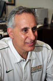 John D'Argenio has run the athletics department since 1993. He started at the school in 1985, as a sports information director.