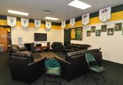 The men's basketball team (locker room seen here) had a spurt of success from 2008-2010, earning three trips in a row to the NCAA Tournament (aka March Madness). Last year, the team tied the school record for losses, and hired a new coach, Jimmy Patsos.