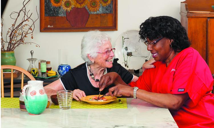 Bayada home health aide Frances Beatty helps client Frances S. with her meal.