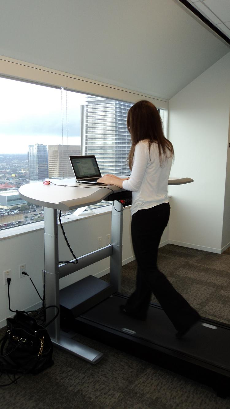 Accenture Plc employee Mackenzie Cooke works and walks on a treadmill work station at the firm's Houston office. Accenture had the highest score on HBJ's 2013 Healthiest Employers list, which honors companies for their workplace wellness efforts.   Click here to see all the companies that made HBJ's 2013 Healthiest Employers list.