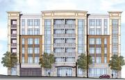 Spectrum Properties is developing a seven-story apartment building on West Trade, a block from the ballpark.
