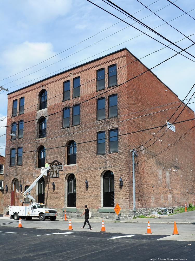 Charmant Finishing Work Continues On The Exterior Of Warehouse 71, An Apartment  Building In Downtown Cohoes