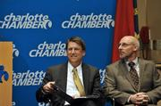 N.C. Gov Pat McCrory (left) and MetLife Executive Vice President Eric Steigerwalt sit together at the Charlotte Chamber's welcome announcement for the insurance and financial-services giant, which is bringing 2,600 jobs to Charlotte and Cary.