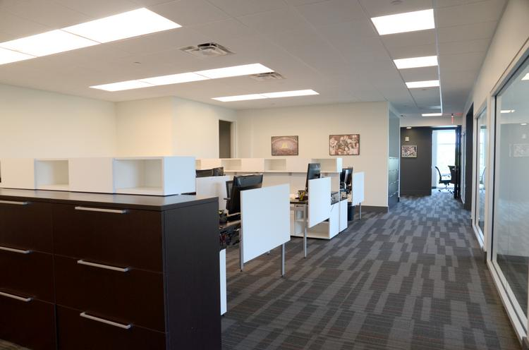 Glassed in offices and spacious work areas are part of the design at XOS new office space in downtown Orlando.