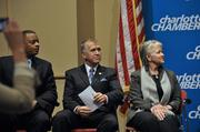 From left are Charlotte Mayor Anthony Foxx , N.C. House Speaker Thom Tillis and N.C. Commerce Secretary Sharon Decker listen to MetLife executive Eric Steigerwalt, who will lead the local operation, at a Charlotte Chamber announcement.