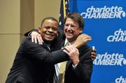 N.C. Gov. Pat McCrory (right) invited Charlotte Mayor Anthony Foxx to pose for a hug for the cameras — despite their obvious political division.