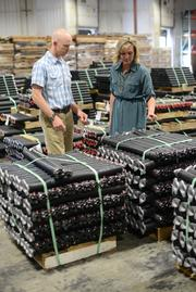 Jodi Boldenow (CEO and co-owner) and her brother Jeremy Sizer (COO and Co-owner) look at pallets of garage door springs that will be shipped out. IDC ships 25 million pounds of springs per year.