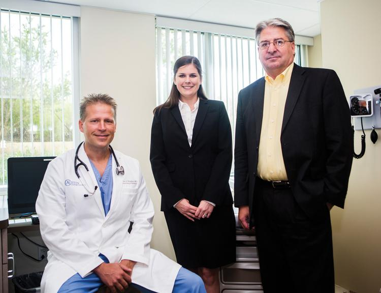 From left, oncologist Dr. Brian Shimkus, genetic counselor Lauren Youngborg and CEO Joe Deuschle of Austin Cancer Centers at its facility in Lakeway.