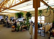 Employees customized their work areas at Puppet Labs' Pearl District offices. Above, a bike hangs over its owner's desk.