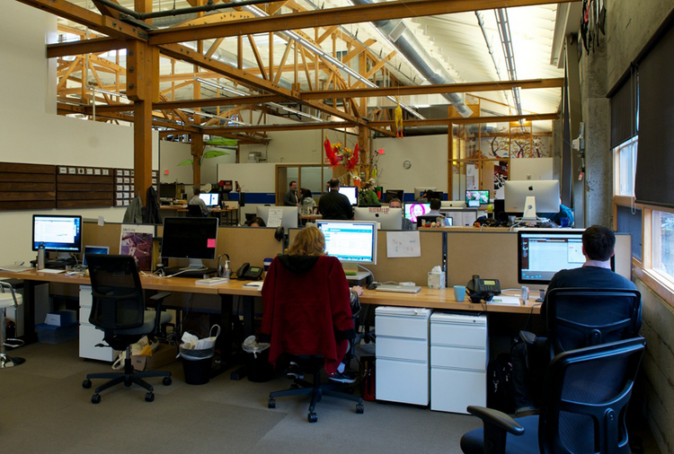Employees work in the open at Puppet Labs' Pearl District offices.