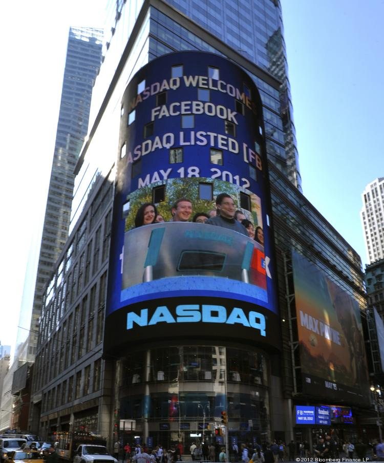 An image of Facebook Inc. executives is projected on a screen at the Nasdaq MarketSite in New York on Friday, May 18, 2012.