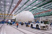 ROLLING FORWARD: In December 2011, the first South Carolina-built 787 Dreamliner moved through final assembly in Boeing's vast North Charleston plant. The building has the largest uninterrupted floor area of any Boeing plant, a key factor in the site's competitive advantage.