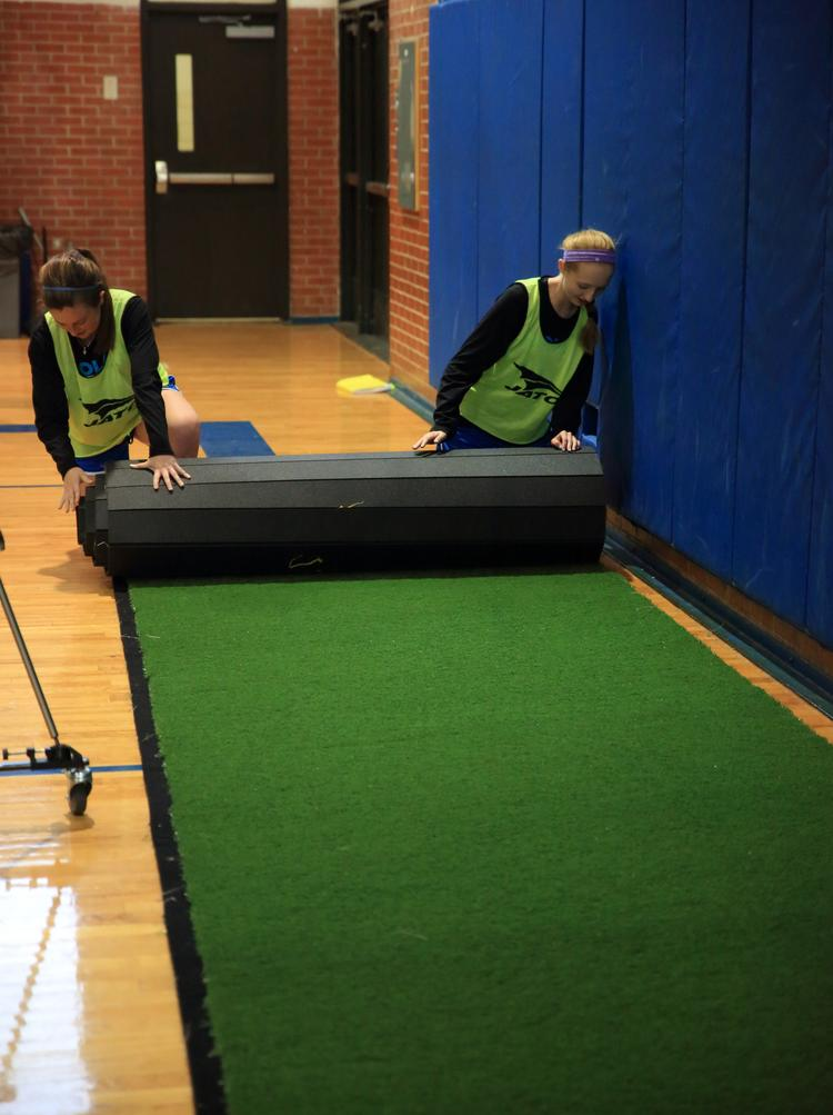 GymTurf 365 is rolled out in five-foot-wide strips.