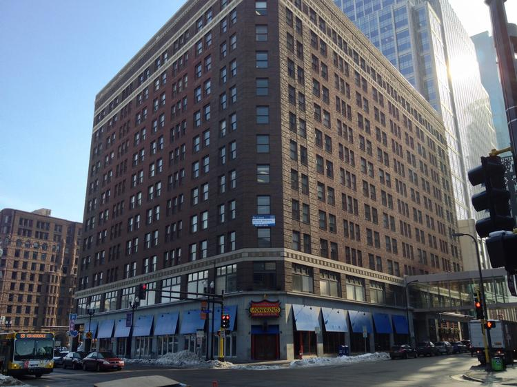 Heartland Realty Investors wants to convert the historic Plymouth Building into an upscale Conrad hotel, sources said.