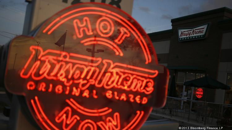 An Illuminated Krispy Kreme Hot Light Signals To Passing Motorists That Hot  Doughnuts Are Currently Rolling