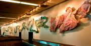 The River, by Peter Hite, a 500-foot mosaic located in Baggage Claim, is about the stream of world culture.
