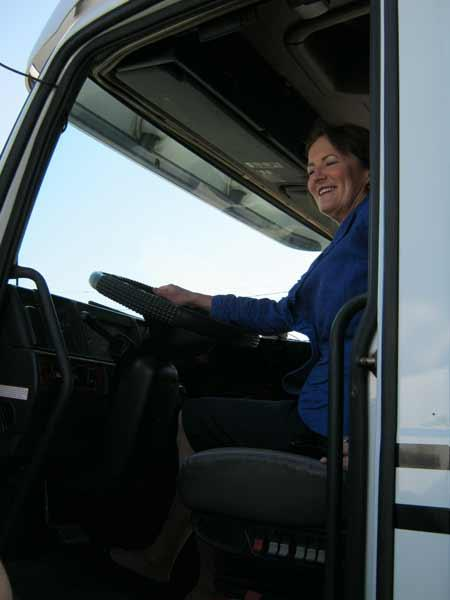 Karen Mills, administrator of the U.S. Small Business Administration, climbs into a big rig at Trucks-E-Quip Inc. in Tampa.
