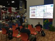Participants at the Unconventional Resources Technology Conference watch a presentation from Houston-based Global Geophysical Services.
