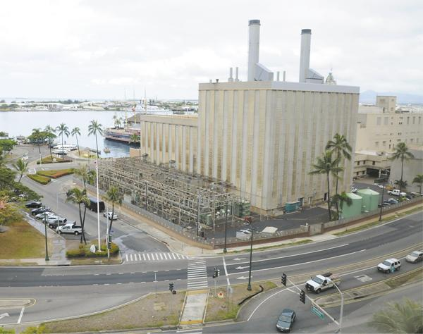 Hawaiian Electric Co. began the process to shut down its Downtown Honolulu oil-fired power plant, seen here in this file photo, on Friday.