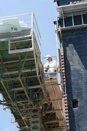 A bricklayer works on a new office building at the Town Center.