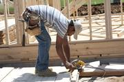 Oscar Aguilar with B&L Construction Co. worked at a new home construction site at Norton Commons.