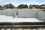A basement and foundation readied for construction of a home in Stonegate Manor in Sellersburg, Indiana.