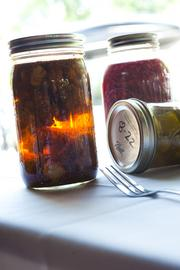 Pickled cauliflower, pickles and shredded red cabbage are ready for the eating.