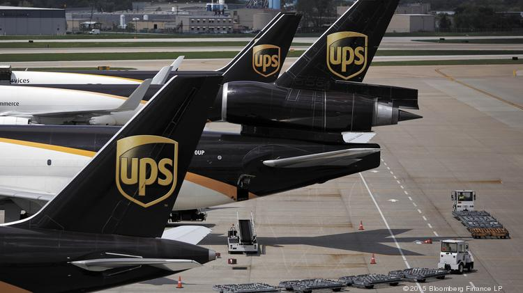 Cargo jets sit parked on the tarmac while being unloaded during the afternoon sort at the United Parcel Service Inc. (UPS) Worldport facility in Louisville, Kentucky, U.S., on Tuesday, April 21, 2015. United Parcel Service Inc. is scheduled to release quarterly earnings results on April 28. Photographer: Luke Sharrett/Bloomberg