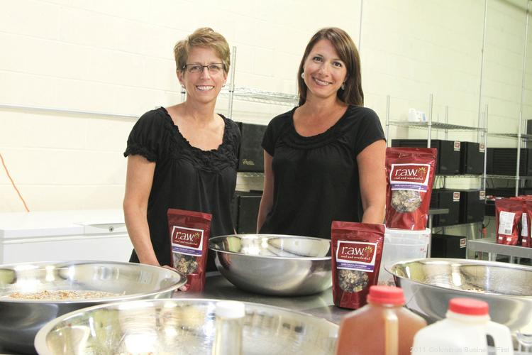 Tricia Caldwell, left, began making raw snacks at home a few years ago. The combinations of fruits, nuts and grains proved irresistible to her workout buddy, Angela Zody. The two now operate their raw snacks business with 13 employees out of a commercial space in Hilliard.