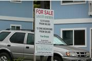 A sign displays the prices of the units at the Lanai City Apartments.