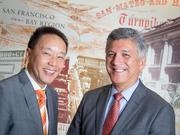 """We aim to fund nonprofits that produce quantifiable results in helping low- and moderate-income families,"" says Randy Chun, left, with Mario Diaz."