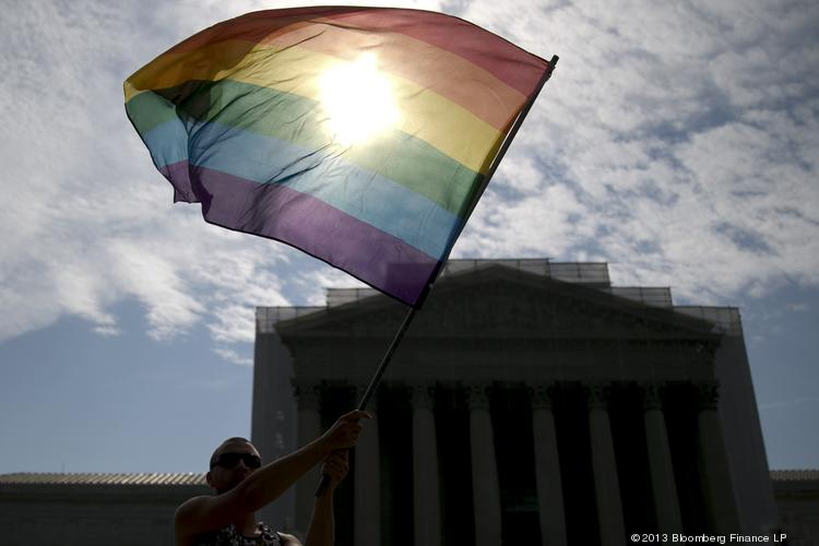 Vin Testa, a supporter of same-sex marriage, waves a rainbow colored flag outside the U.S. Supreme Court while waiting for a ruling on two gay-marriage cases in Washington, D.C., U.S., on June 24.