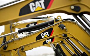 Caterpillar Inc. excavators sit on display at the Altorfer CAT dealership in Bettendorf, Iowa, in October 19, 2012.