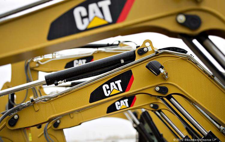 Caterpillar Inc. excavators sit on display at the Altorfer CAT dealership in Bettendorf, Iowa.