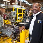 GM Tonawanda plant manager assists with robot donation to RIT