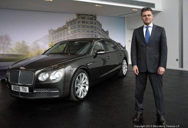 Wolfgang Schreiber, CEO of Bentley Motors, poses in front of a new Flying Spur automobile at the company's headquarters in Crewe, U.K., on Friday. Bentley, the ultra-luxury car brand owned by Volkswagen AG, unveiled their latest model, the Bentley Flying Spur at the Geneva Motor Show this week.