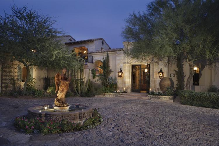 This 19,500-square-foot Western-style mansion is on sale in Paradise Valley for $13.75 million. Click through for more images of the home.