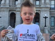 """Ari sports a T-shirt that says, """"I love homies with extra chromies."""" The photo went viral, catapulting Global Down Syndrome Foundation to the top of the list as a social powerhouses."""