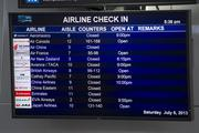Following Saturday's crash, flights out of SFO were canceled or delayed hours. On Sunday, the average delay time was nine hours.
