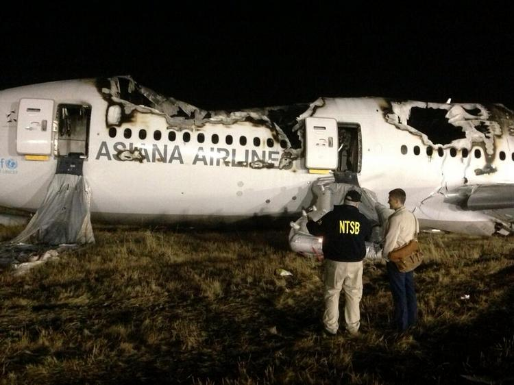 Investigators with the National Transportation Safety Board (NTSB) arrive at the scene of the Asiana Flight 214 crash at San Francisco International Airport.