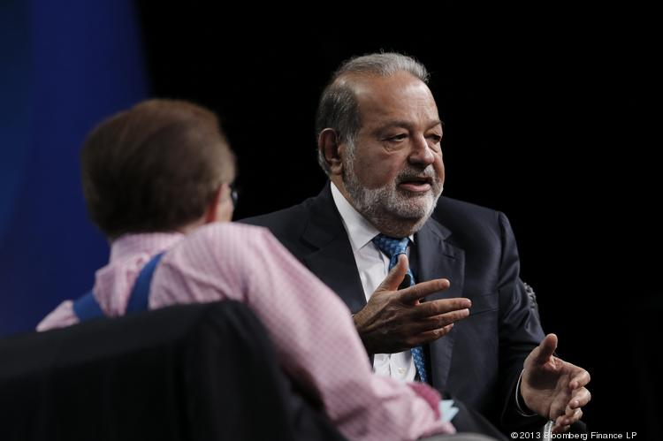 Carlos Slim (right) at the Milken Institute Global Conference in Beverly Hills, California, earlier this year. The Mexican billionaire was in Boston yesterday to announce new funding for a Latin-America-focused genomics initiative at the Broad Institute of Harvard and MIT.