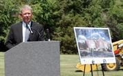 Ron Baldwin, chairman and founder of CrossFirst Bank, speaks at the groundbreaking for the bank's Wichita headquarters.