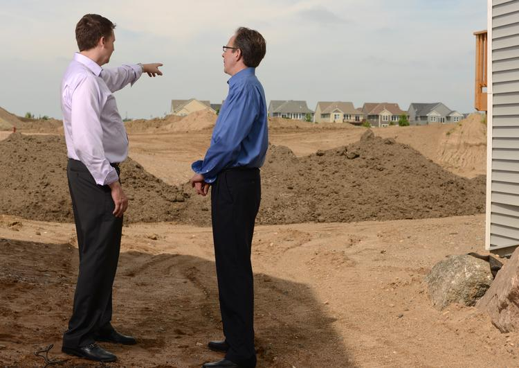 Marv McDaris, division president of Pulte,  and Ian Peterson, VP of Land for Pulte, at the Donegal development in Maple Grove, from a Business Journal story on homebuilding in July