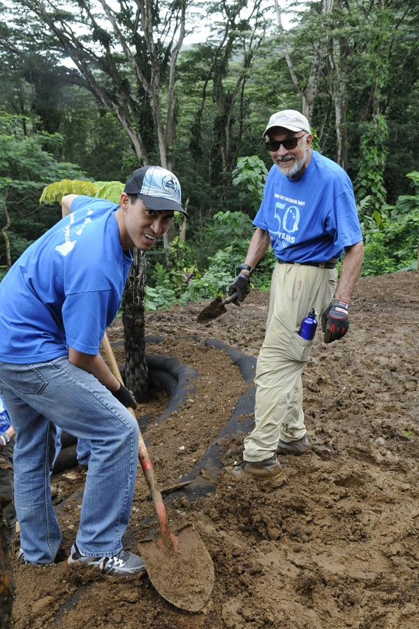 Kumau Pineda Akiona, left, attorney for Damon Key Leong Kupchak Hastert, and Kenneth Kupchak, attorney and president of the law firm, help to create a sustainable garden at the Lyon Arboretum last month. The community outreach effort is in conjunction with the law firm's celebration of its 50th anniversary.