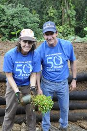 Damon Key Leong Kupchak Hastert attorney Doug Smith, right, and wife Kelly Smith help to install a sustainable garden at the Lyon Arboretum, part of the law firm's outreach activities to mark its 50th anniversary.