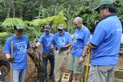From left, Kumau Pineda Akiona, Mathew Evans, Kenneth Kupchak, Greg Kugle and Mike Yoshida of Damon Key Leong Kupchak Hastert helped to plant Hapuu fern at the Lyon Arboretum last month as part of the firm's volunteer outreach activity marking its 50th anniversary.