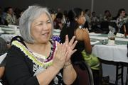 Gwen Miyasato, chief of staff at HMSA, applauds the recipients of HMSA's 2013 Kaimana Awards and scholarship program at the Hawaii Convention Center last month.