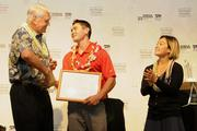 From left, Robert Hiam, former president and CEO for HMSA, recognizes Lucas Gushikuma of Kauai High School as a 2013 Kaimana Scholarship recipient in the Kauai Interscholastic Federation as Clarissa Chun, Olympic bronze medalist in women's freestyle wrestling, looks on.