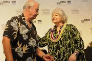 From left, Anuenue School principal Charles Naumu is congratulated by HMSA Senior Vice President Linda Katagiri on Anuenue School being awarded first place in the Oahu Interscholastic Association and recognized at HMSA's 2013 Kaimana Awards and scholarship program.